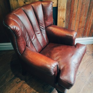 Fluted back vintage leather armchair