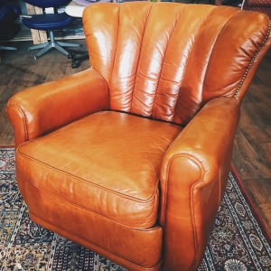Tan fluted leather armchair side view