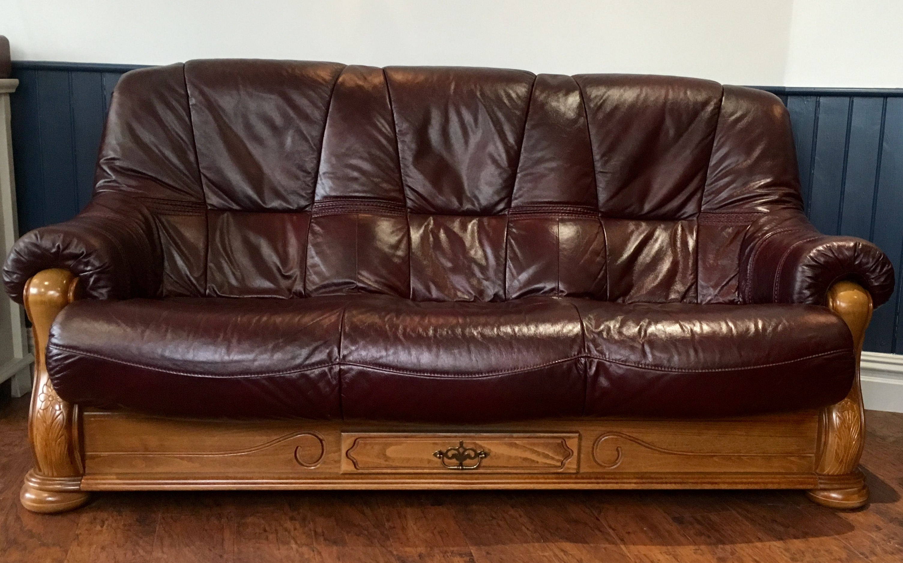 Burgundy leather seat sofa and reclining chair
