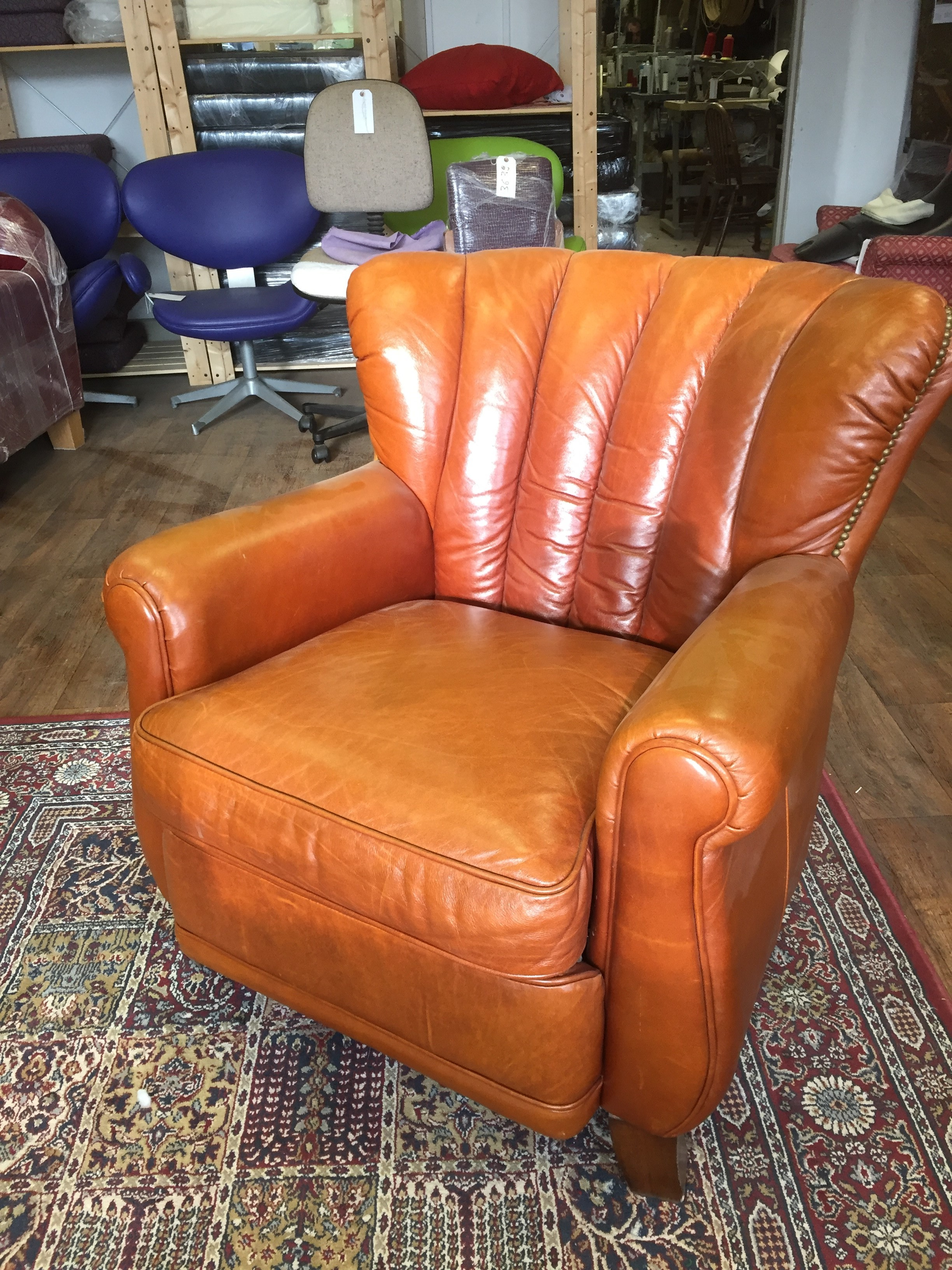 Tan fluted leather armchair