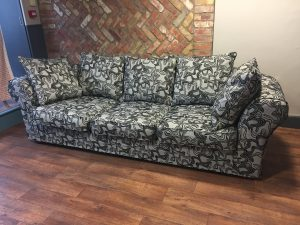 Squiggly fabric loose cover on large three seat sofa