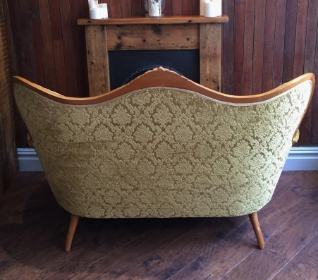 back of gold vintage sofa
