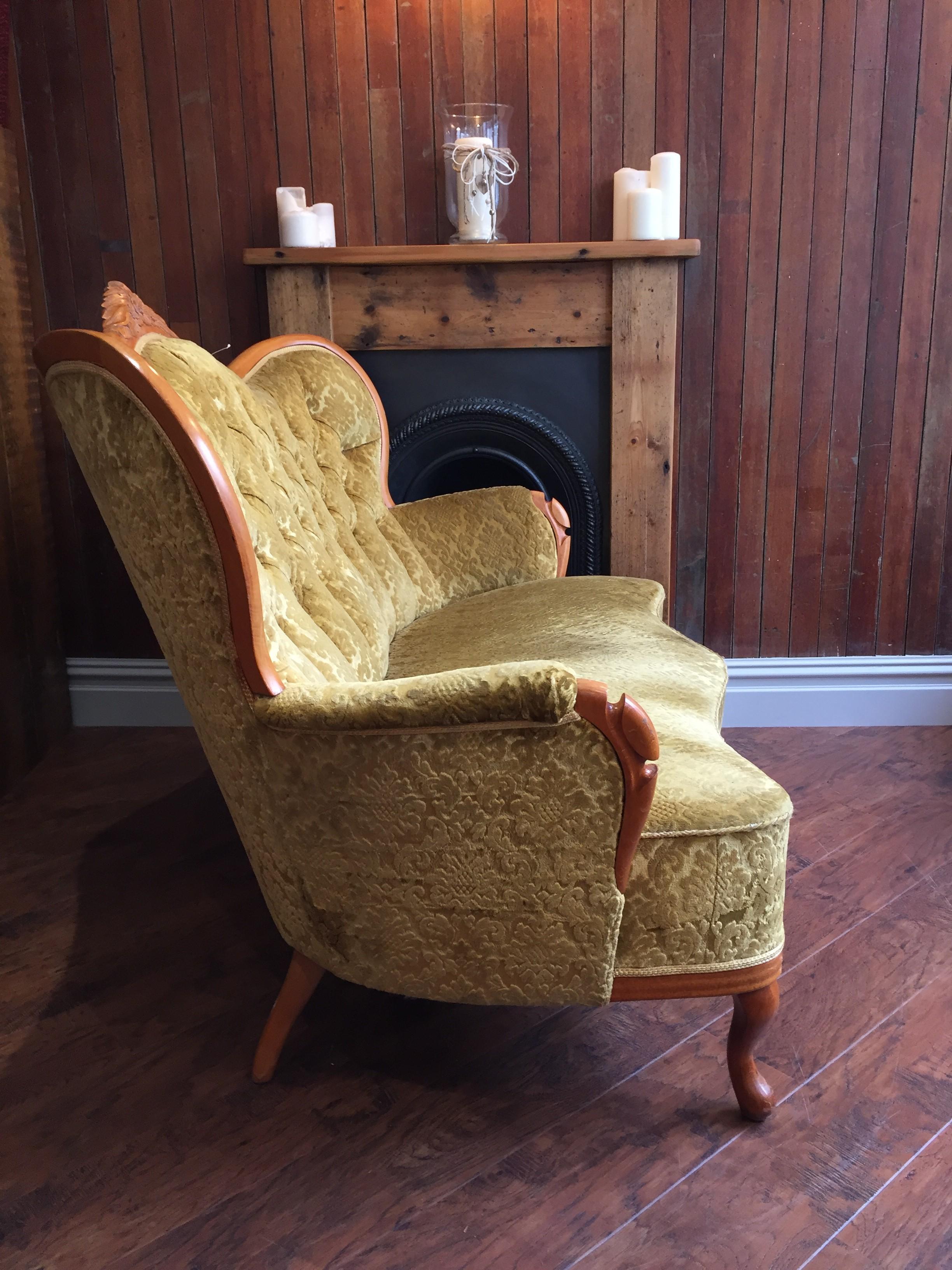 side of gold vintage sofa