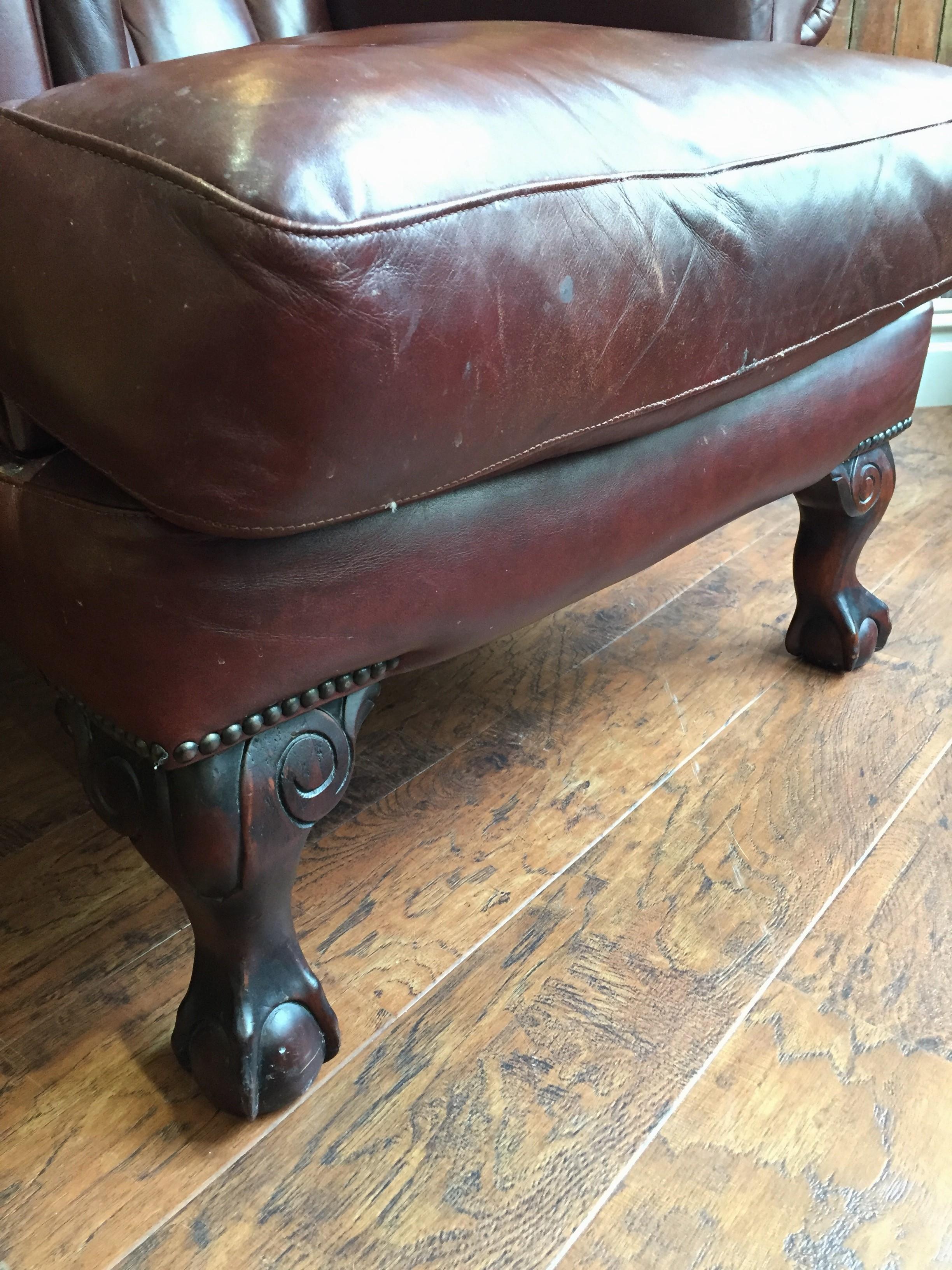 Legs on leather armchair