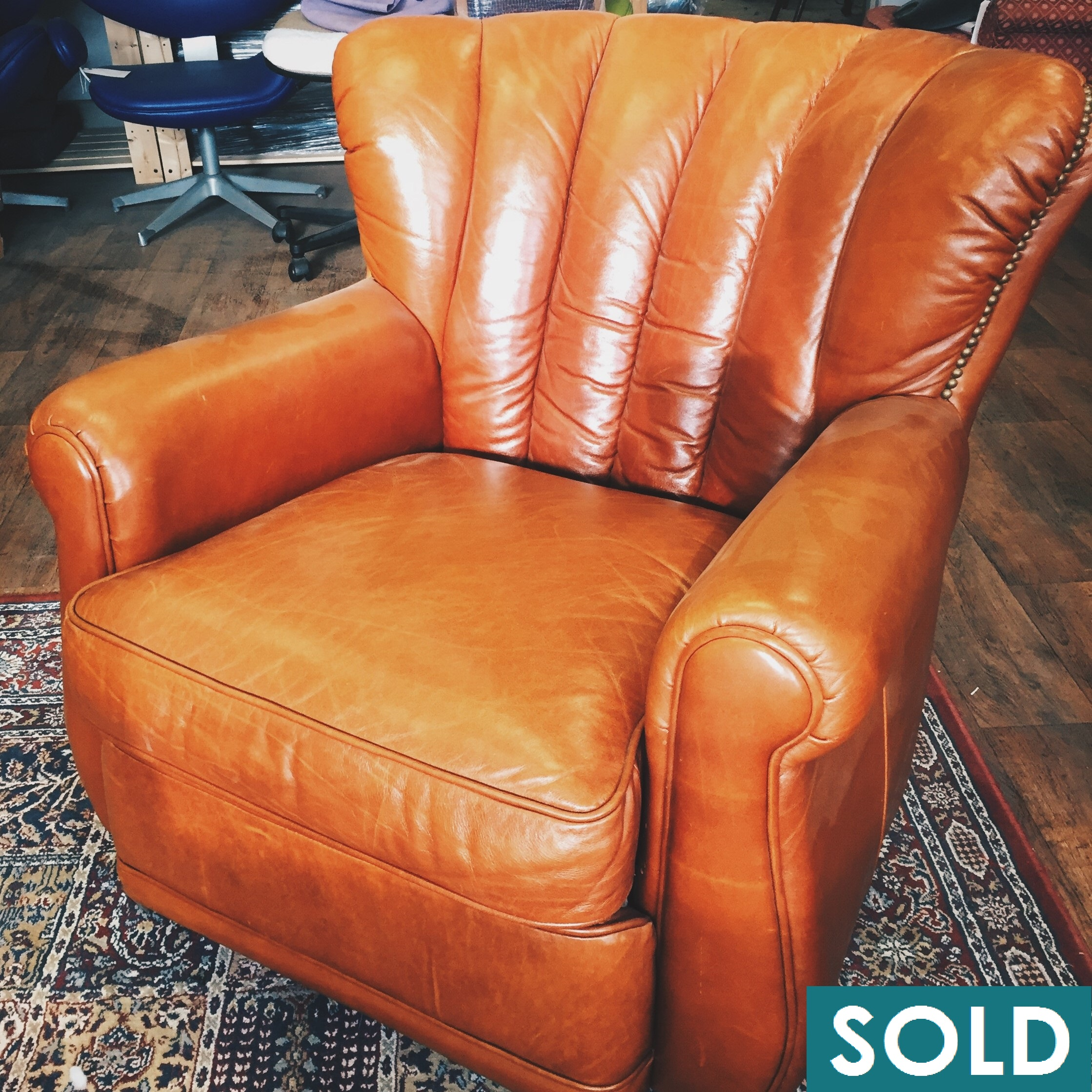 Sold Fluted leather armchair